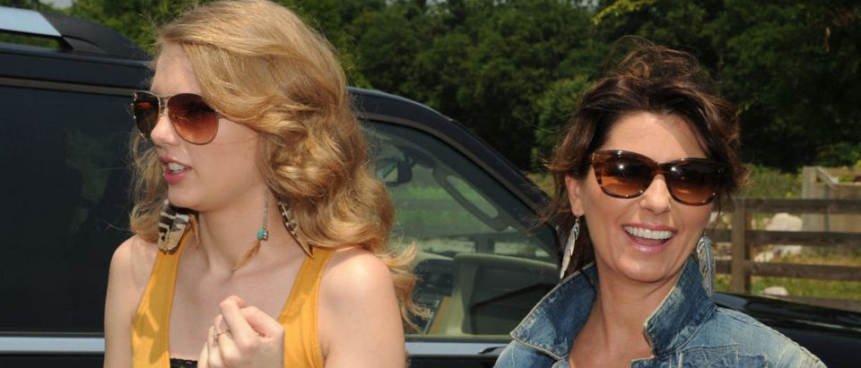 """THOMPSON'S STATION, TN - JUNE 06: Singers and Songwriters Taylor Swift and Shania Twain during the recreation of """"Thelma & Louise"""" for CMT Music Awards airing on June 8, 2011 8pm EST on CMT Country Music TV. This Segment taped on June 6, 2011 in Thompson's Station, Tennessee. (Photo by Rick Diamond/Getty Images for CMT)"""