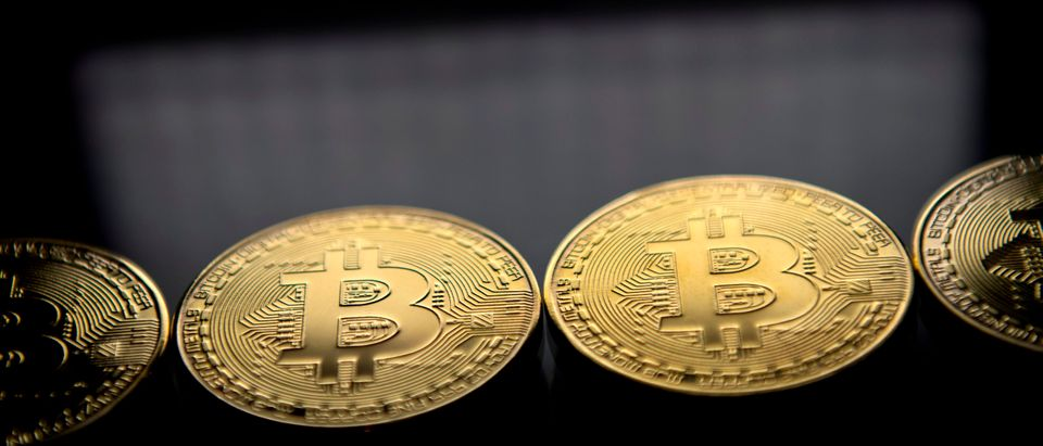Gold plated souvenir Bitcoin coins are arranged for a photograph in London on November 20, 2017.