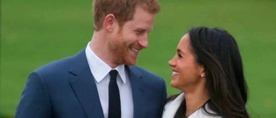 Britain's Prince Harry and his fiancée actress Meghan Markle pose for a photograph in the Sunken Garden at Kensington Palace in west London on November 27, 2017, following the announcement of their engagement. (Photo: DANIEL LEAL-OLIVAS/AFP/Getty Images)