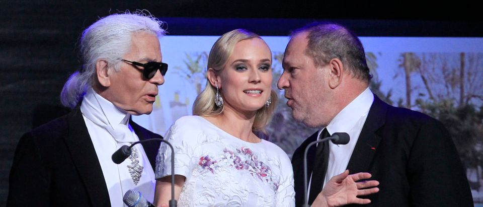 German designer Karl Lagerfeld (L), Actress Diane Kruger (C) and Film producer Harvey Weinstein attend an auction at the amfAR's Cinema Against AIDS 2012 event in Antibes during the 65th Cannes Film Festival May 24, 2012. Picture taken June 24, 2012. REUTERS/Yves Herman