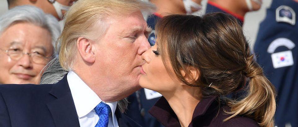 President Donald J. Trump and first lady Melania Trump kiss after arrival at the Osan Air Base in Pyeongtaek, Gyeonggi-do, South Korea, Nov. 7, 2017. REUTERS/Song Kyung-seok/Pool
