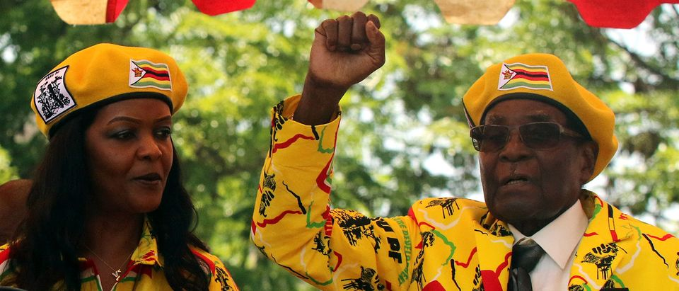 President Robert Mugabe and his wife Grace Mugabe attend a rally of his ruling ZANU-PF party in Harare