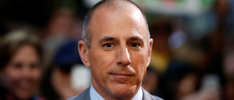 "Matt Lauer pauses during a break while filming NBC's ""Today"" show at Rockefeller Center in New York, May 3, 2013. REUTERS/Lucas Jackson/File Photo"