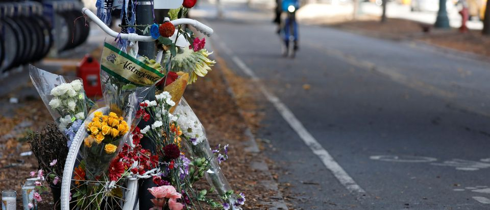 An existing roadside memorial, also known as ghost bike, that is now used to remember the victims of the Tuesday's attack alongside a bike path at Chambers Street in New York City, is pictured in New York