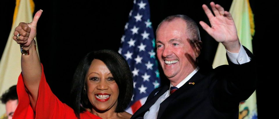 Murphy and Oliver celebrate after being elected Governor of New Jersey in Asbury Park