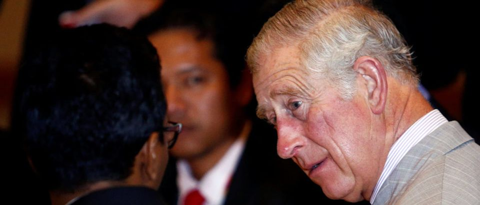 Britain's Prince Charles listens to a youth during the Commonwealth Youth Summit at the University of Nottingham Malaysia Campus in Semenyih