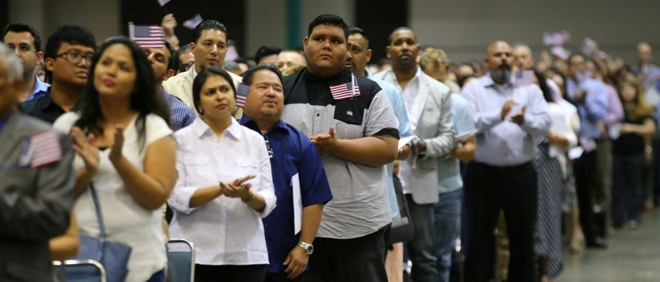 Mexican Erick Ayala, 21, (C) is sworn in as a United States citizen during a U.S. citizenship ceremony in Los Angeles, U.S., July 18, 2017. Picture taken July 18, 2017. REUTERS/Mike Blake
