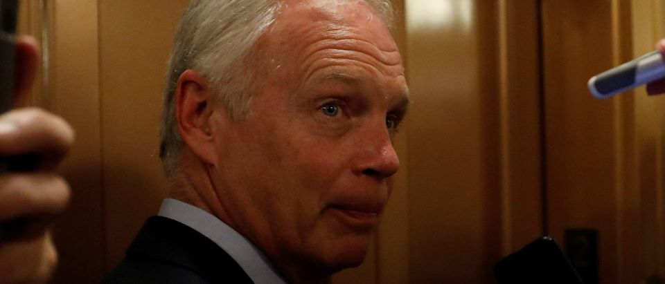 """Senator Ron Johnson (R-WI) speaks with reporters after the failure of the """"skinny repeal"""" health care bill on Capitol Hill in Washington"""
