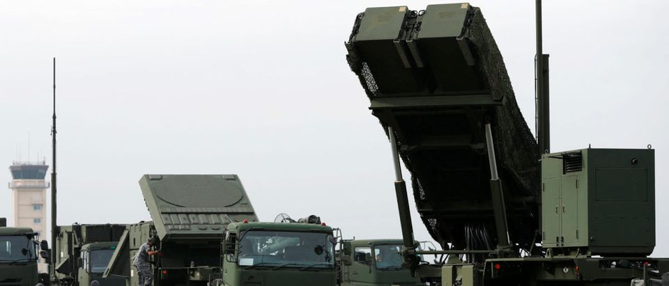 Japan Self-Defense Forces (JSDF) soldiers take part in a drill to mobilise their Patriot Advanced Capability-3 (PAC-3) missile unit in response to a recent missile launch by North Korea, at U.S. Air Force Yokota Air Base in Fussa on the outskirts of Tokyo, Japan August 29, 2017. REUTERS/Issei Kato - RC13D7B4E1C0