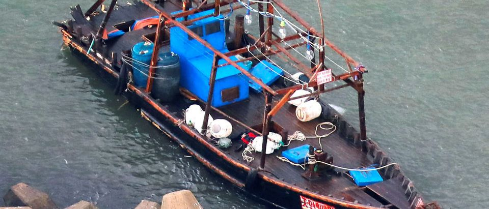 A wooden boat, which according to a police official carried eight men who said they were from North Korea and appear to be fishermen whose vessel ran into trouble, is seen near a breakwater in Yurihonjo, Akita Prefecture, Japan November 24, 2017. Mandatory credit Kyodo/via REUTERS