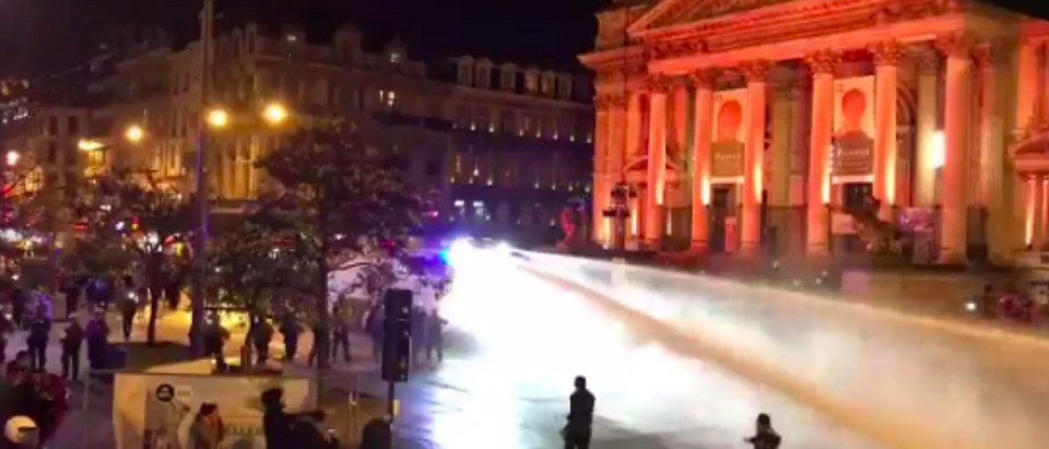Brussels police use water cannons to disrupt riots after Morocco qualify for the World Cup. (Bekah Molony/screenshot from Twitter)