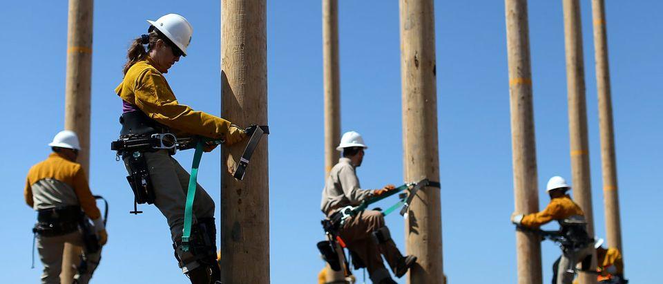 Utility Worker Trainees Learn Pole-Climbing Skills