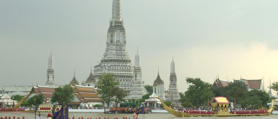 The Royal Barges in front of Wat Arun make their way along the Chao Phya River during a practise procession in Bangkok October 21. The royal procession will be held in November to mark His Majesty the King's 72nd birthday.
