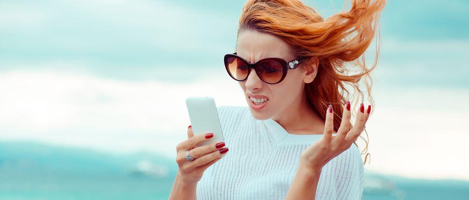 Woman_exasperated_smartphone