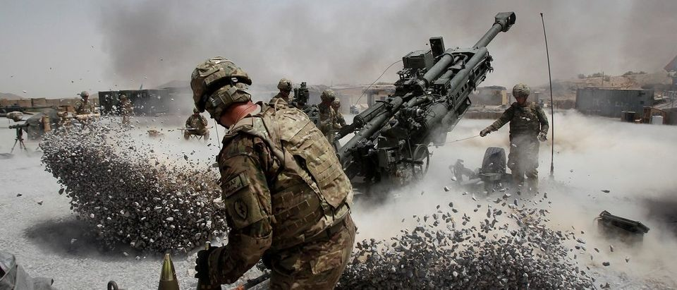 U.S. Army soldiers from the 2nd Platoon, B battery 2-8 field artillery, fire a howitzer artillery piece at Seprwan Ghar forward fire base in Panjwai district