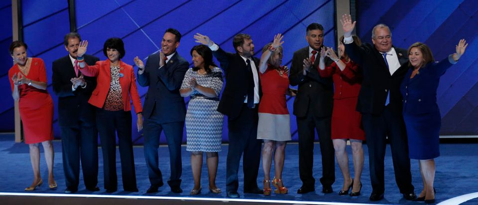 Members of the Congressional Hispanic Caucus stand ontage at the Democratic National Convention in Philadelphia, Pennsylvania, U.S. July 25, 2016. REUTERS/Mike Segar