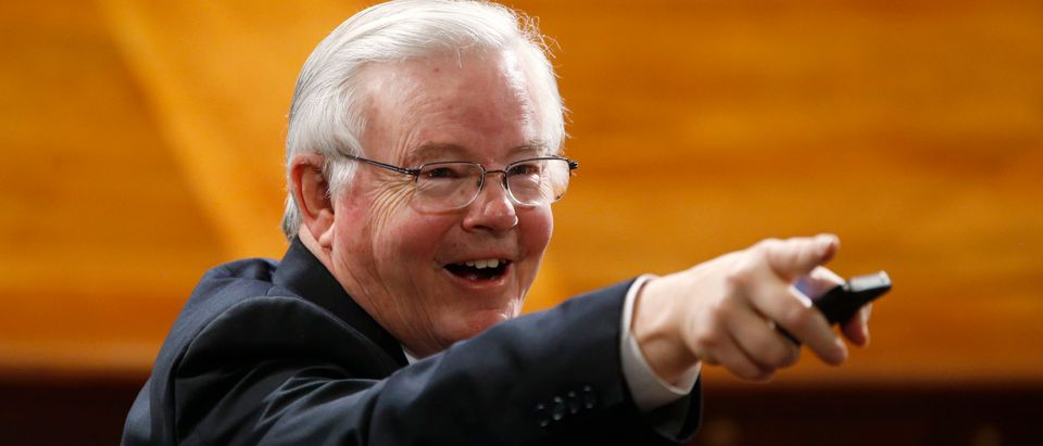 Rep Joe Barton (R-TX) points to another attendee in the House chamber prior to Israeli Prime Minister Benjamin Netanyahu's address to a joint meeting of Congress on Capitol Hill in Washington, March 3, 2015. REUTERS/Jonathan Ernst