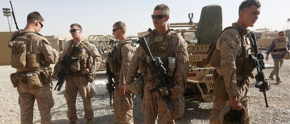 U.S. Marines prepare themselves before going training with Afghan National Army (ANA) soldiers in Helmand province