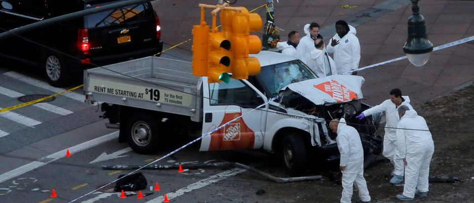 Police investigate a vehicle allegedly used in a ramming incident on the West Side Highway in Manhattan, New York, U.S.