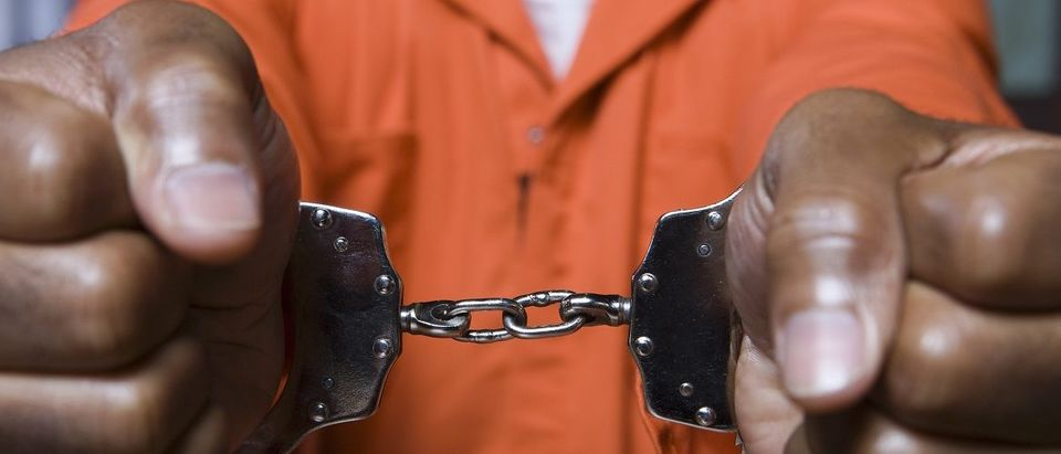 A black prisoner is in handcuffs. (sirtravelalot/Shutterstock)