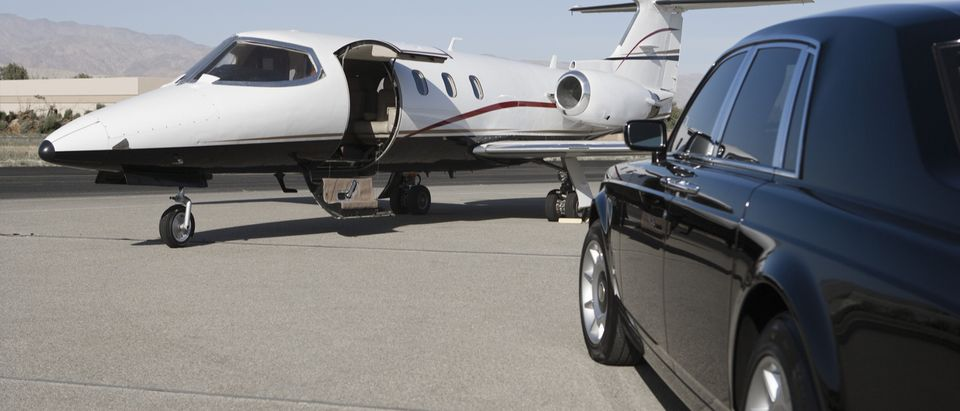 Private jet waits at airport near limousine (Photo: Shutterstock/sirtravelalot)