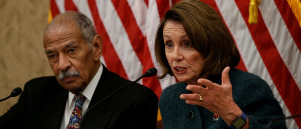 House Minority leader Nancy Pelosi and Rep. John Conyers take part in a discussion panel on President Trump's Muslim and refugee ban in the U.S. Capitol in Washington