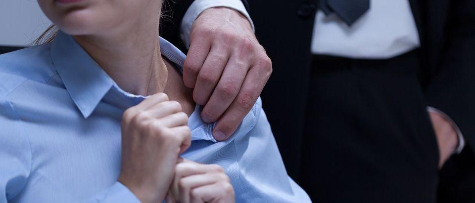 Sexual assault in the workplace. Photographee.eu/Shutterstock.