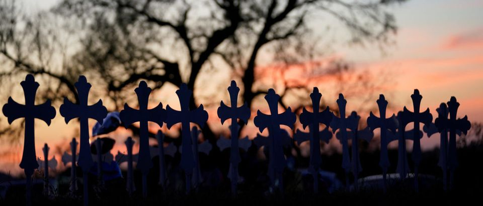 Crosses are placed near a vigil in the memory of those killed in the shooting at the First Baptist Church of Sutherland, Texas, U.S., November 6, 2017. REUTERS/Rick Wilking