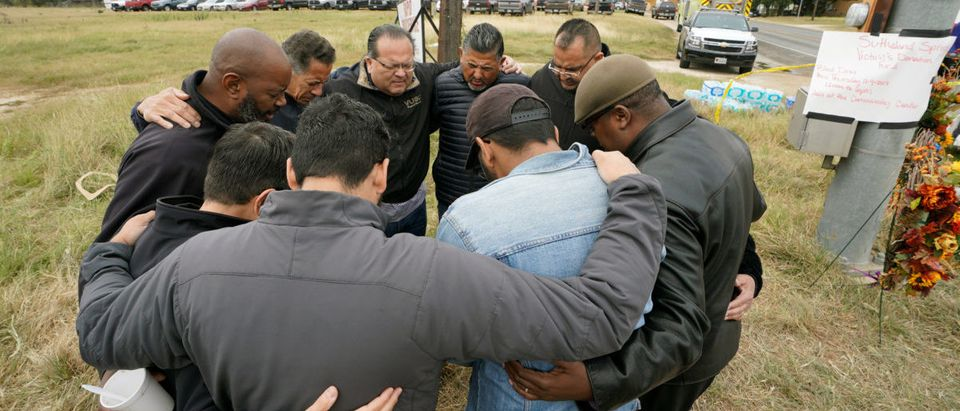 South Texas pastors pray at the site of the First Baptist Church shooting in Sutherland Springs, Texas, November 8, 2017. REUTERS/Rick Wilking