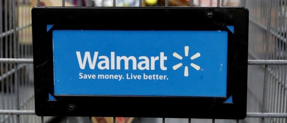 FILE PHOTO - A customer pushes a shopping cart at a Walmart store in Chicago