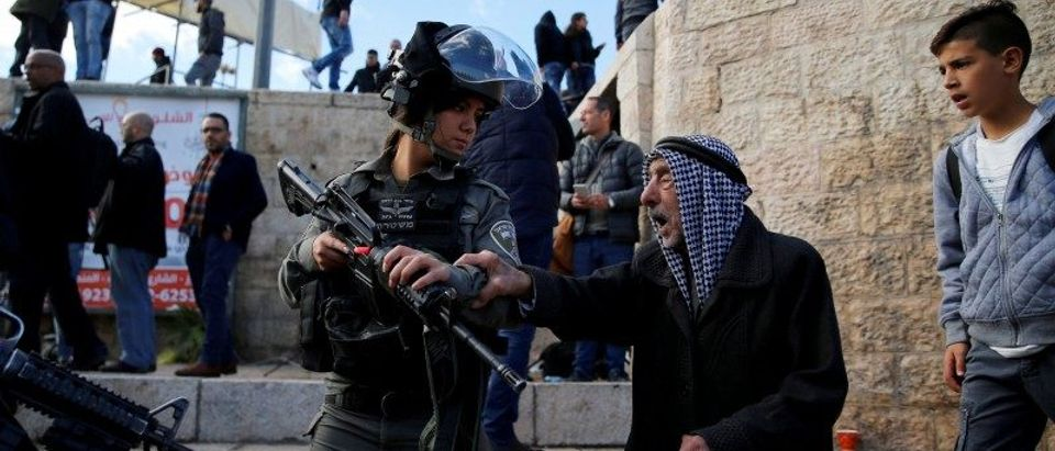 A Palestinian man argues with an Israeli border policewoman during a protest following U.S. President Donald Trump's announcement that he has recognized Jerusalem as Israel's capital, near Damascus Gate in Jerusalem's Old City