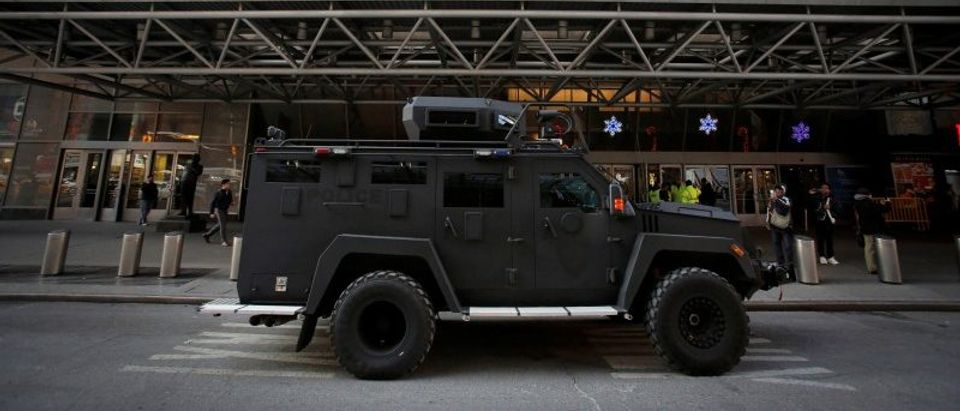 An armored vehicle belonging to the New York Port Authority sits beneath a Christmas decoration at the entrance of the New York Port Authority Bus Terminal following an attempted detonation during the morning rush hour, in New York City