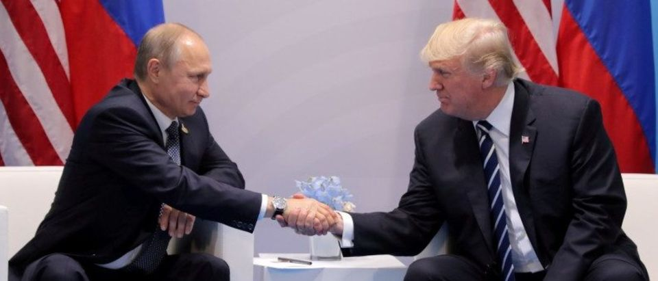FILE PHOTO: U.S. President Donald Trump shakes hands with Russia's President Vladimir Putin during their bilateral meeting at the G20 summit in Hamburg, Germany July 7, 2017. REUTERS/Carlos Barria/File Photo | Trump Has Putin On Notice