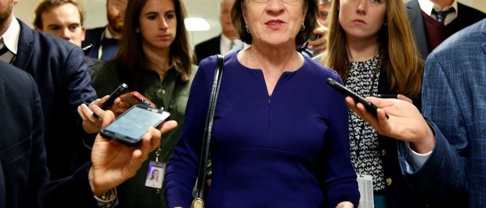 Senator Susan Collins (R-ME) speaks to reporters as she arrives for a nomination vote on Capitol Hill in Washington