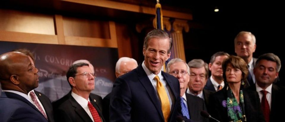 Sen. John Thune, accompanied by members of the Republican Conference, speaks at a news conference about the passage of the Tax Cuts and Jobs Acts at the U.S. Capitol in Washington