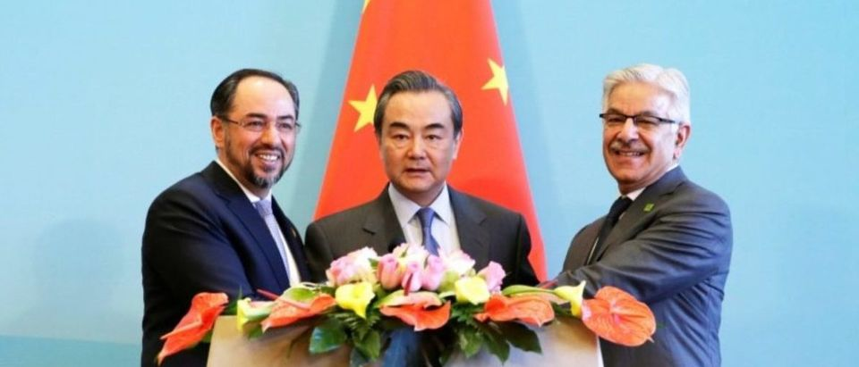 Afghan FM Rabbani, Chinese FM Wang Yi and Pakistani FM Asif attend a joint news conference after the 1st China-Afghanistan-Pakistan Foreign Ministers' Dialogue in Beijing