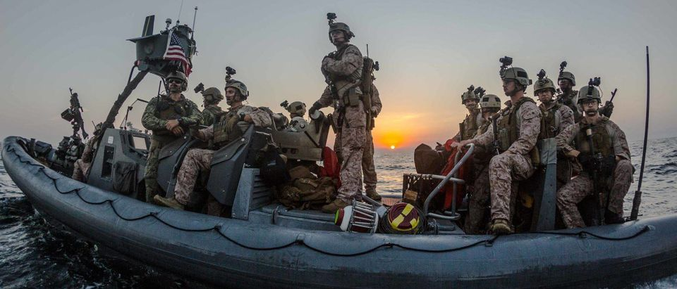 As the sun sets over the Gulf of Aden, Marines with 2nd Platoon, Maritime Raid Force, 11th Marine Expeditionary Unit position their rigid-hulled inflatable boat to conduct a visit, board, search and seizure mission as part of Exercise Alligator Dagger in December 2017. (U.S. Marine Corps photo by Gunnery Sgt. Robert B. Brown Jr.)