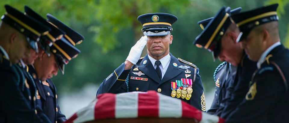 Members of The 3d U.S. Infantry Regiment (The Old Guard) participate in the graveside service for U.S. Army Sgt. Willie Rowe in Section 60 of Arlington National Cemetery, Arlington, Virginia, Aug. 8, 2017. (Photo credit: Arlington National Cemetery Flickr)