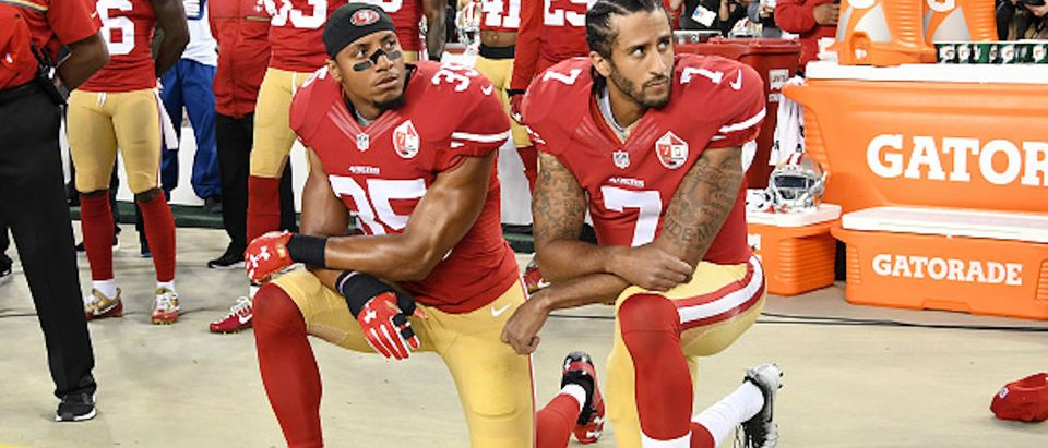 SANTA CLARA, CA - SEPTEMBER 12: Colin Kaepernick #7 and Eric Reid #35 of the San Francisco 49ers kneel in protest during the national anthem prior to playing the Los Angeles Rams in their NFL game at Levi's Stadium on September 12, 2016 in Santa Clara, California. (Photo by Thearon W. Henderson/Getty Images)