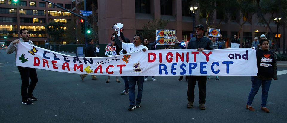 A small group of demonstrators block traffic to demand action by the federal government on the Deferred Action for Childhood Arrivals (DACA) in downtown San Diego