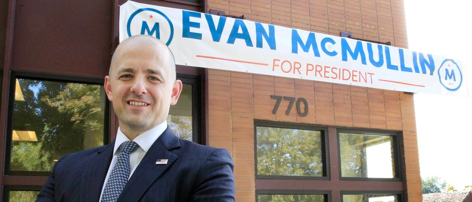 Third party candidate Evan McMullin, an independent, poses for a picture outside his campaign offices in Salt Lake City