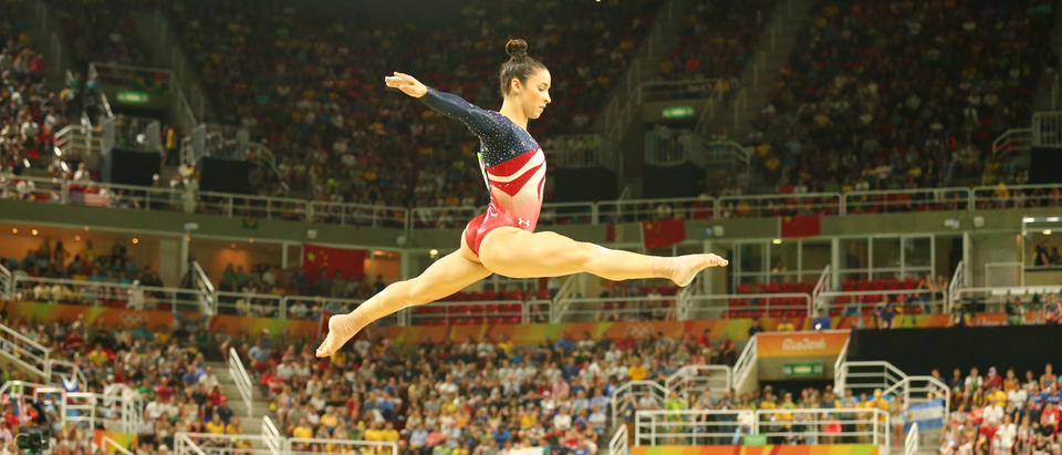 RIO DE JANEIRO, BRAZIL - AUGUST 9, 2016: Olympic champion Aly Raisman of United States competes on the balance beam at women's team all-around gymnastics at Rio 2016 Olympic Games at Rio Olympic Arena Shutterstock/ Leonard Zhukovsky