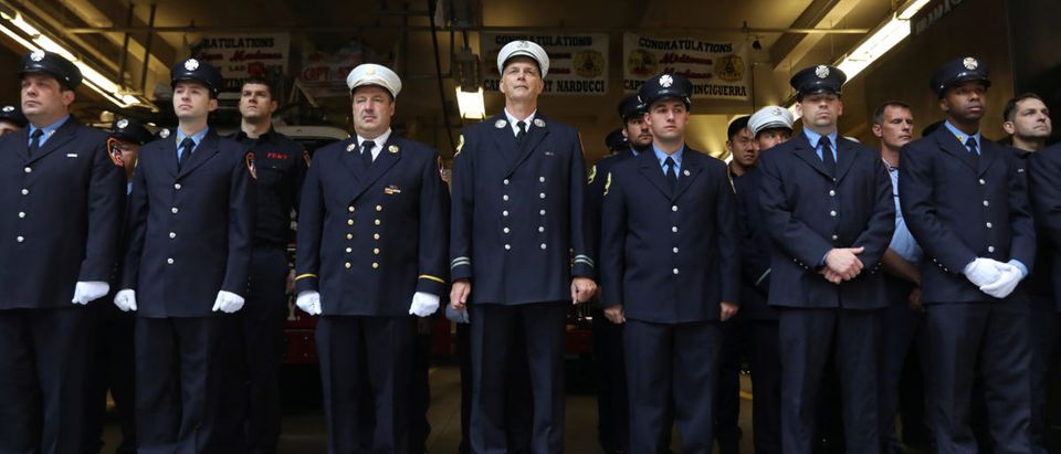 New York City Fire Department (FDNY) firefighters stand in silence outside Engine Company 1 in lower Manhattan during ceremonies marking the 16th anniversary of the September 11, 2001 attacks in New York, U.S. September 11, 2017. REUTERS/Shannon Stapleton