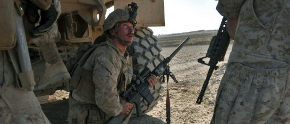 US Marines sniper from 1st Battalion 8th, Bravo company takes his position during an engage with Taliban fighters in Musa Qala district of Helmand province.(Photo credit/ MASSOUD HOSSAINI/AFP/Getty Images)