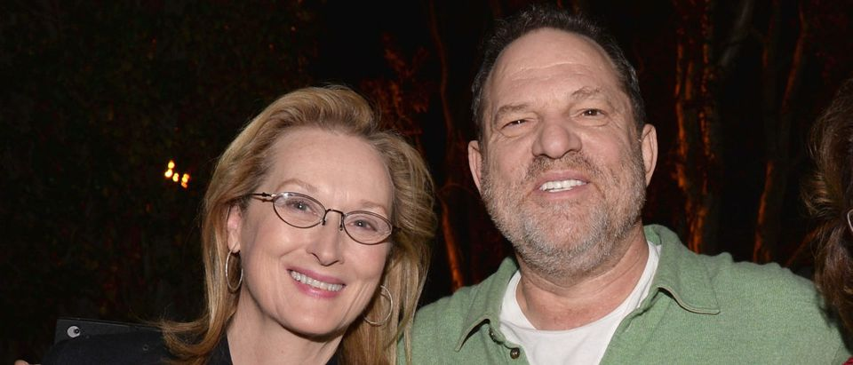 """Actress Meryl Streep and producer Harvey Weinstein attend a Q&A session following a screening of The Weinstein Co.'s """"August: Osage County"""" at the DGA Theater on January 5, 2014 in Los Angeles. (Photo by Alberto E. Rodriguez/Getty Images)"""