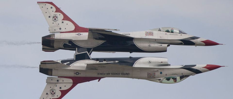 Two US Air Force F-16 Thunderbirds perform during the airshow at Joint Andrews Air Base in Maryland in September 2017. (Photo credit/ANDREW CABALLERO-REYNOLDS/AFP/Getty Images)