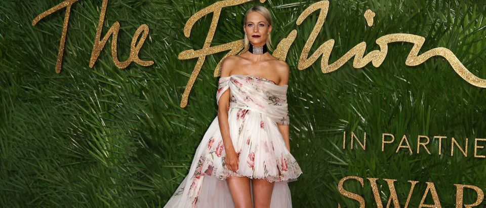 Poppy Delevingne posing on the red carpet after arriving at the British Fashion Awards 2017 in London on December 4, 2017. (Photo credit/ read DANIEL LEAL-OLIVAS/AFP/Getty Images)