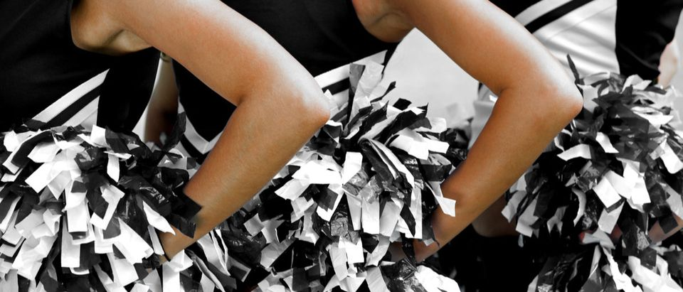 High School cheerleaders are now kneeling too