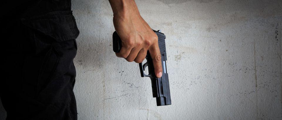 Killer with gun -- Shuterstock-Avigator Thailand