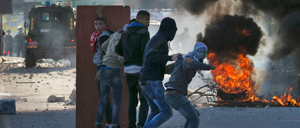 Palestinian protestors clash with Israeli security forces at Hawara checkpoint, south of the West Bank city of Nablus, following a demonstration against US President Donald Trump's decision to recognise Jerusalem as the capital of Israel on December 8, 2017.